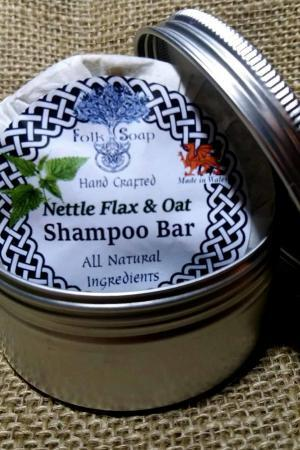 nettle flax and oat solid shampoo bar in travel tin